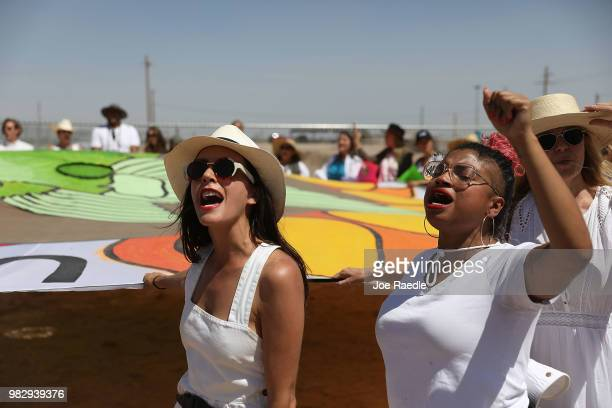 People protest near the tent encampment recently built at the TornilloGuadalupe Port of Entry on June 24 2018 in Tornillo Texas The group is...