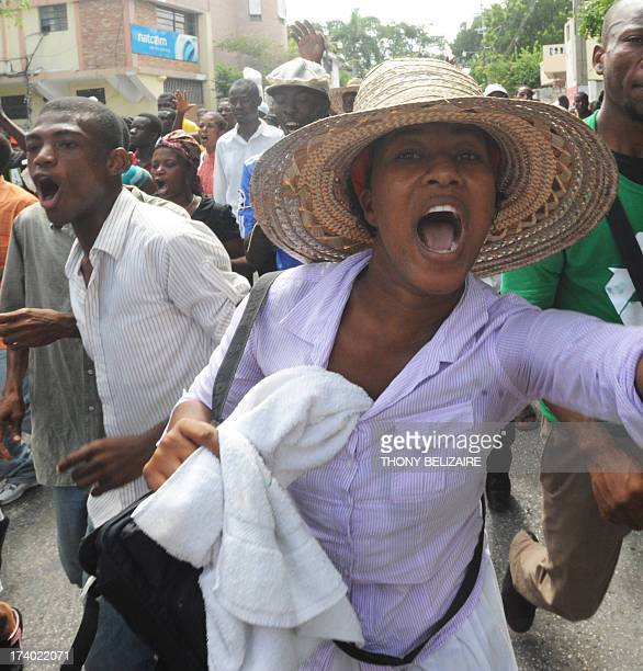 People protest on July 19 2013 in PortauPrince urging lawmakers not to pass legislation that would legalize samesex marriage in Haiti The...