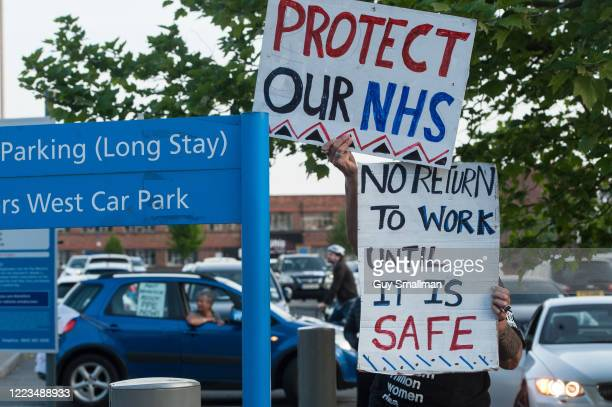 People protest outside North Middlesex Hospital as local residents, NHS staff and police officers applaud key workers on May 7, 2020 in London,...