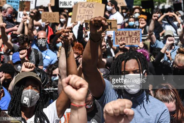 People protest outside of One Police Plaza on June 8 2020 in New York City More than 500 former and current mayor's office staff joined with city...