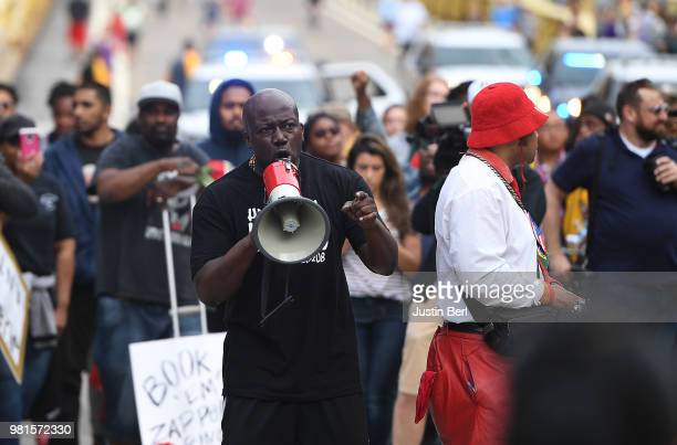 People protest outside of PNC Park over the fatal shooting of Antwon Rose on June 22 2018 in Pittsburgh Pennsylvania East Pittsburgh police officers...