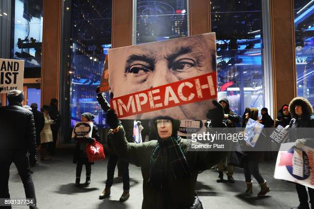 People protest outside of the Fox News Channel headquarters to demand the resignation of President Donald Trump after accusations of sexual assault...
