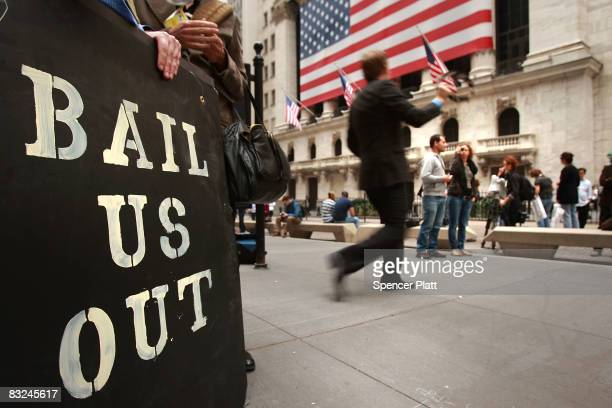 People protest outside of the New York Stock Exchange October 13 2008 in New York City Following a rise in global markets the Dow was up over 400...