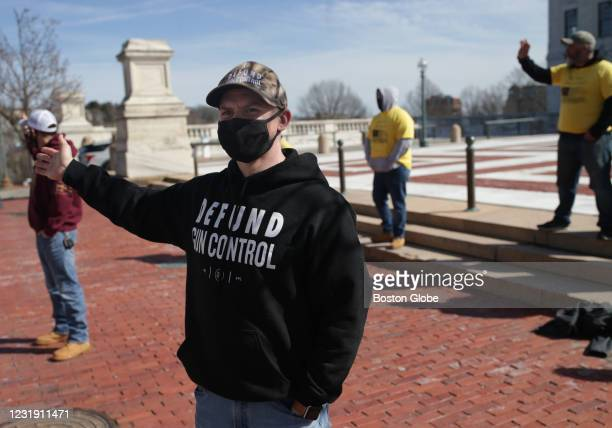 People protest outside of the Rhode Island State Capitol as bills that would either expand gun rights or seek to control firearms were debated in...