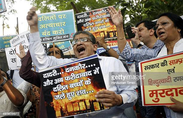 People protest over the Dalit killings in front of Haryana Bhawan on October 21, 2015 in New Delhi, India. Two-and-a-half-year-old Vaibhav and...