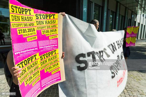 People protest prior to a press conference of Antiimmigration populist Alternative fuer Deutschland party in Berlin Germany on May 23 2018