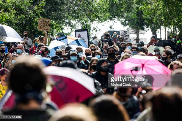 People protest the death of Elijah McClain outside the Aurora Police Department Headquarters on July 25 2020 in Aurora Colorado On August 24 2019...