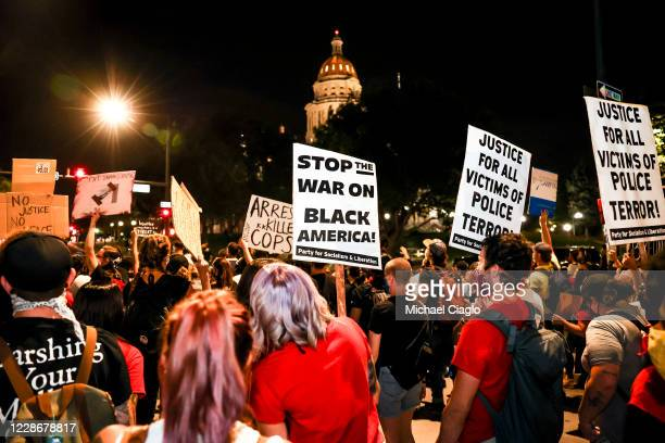 People protest the grand jury decision in the Breonna Taylor case in front of the Colorado State Capitol on September 23 2020 in Denver United States...