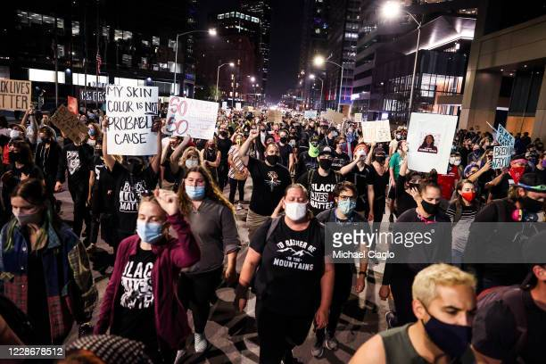 People protest the grand jury decision in the Breonna Taylor case on September 23 2020 in Denver United States The death of Taylor who was shot and...
