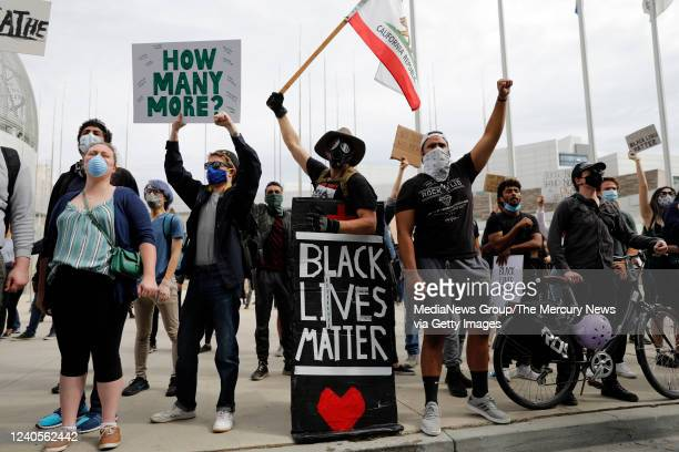 People protest the killing of George Floyd outside of San Jose City Hall in downtown San Jose Calif on Sunday May 31 2020