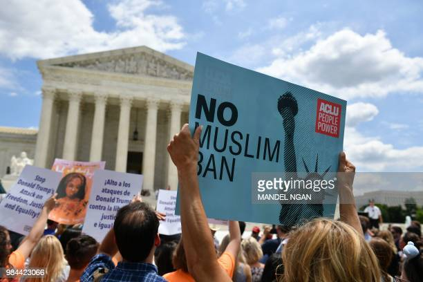 People protest the Muslim travel ban outside of the US Supreme Court in Washington DC on June 26 2018 The US Supreme Court on Tuesday upheld...