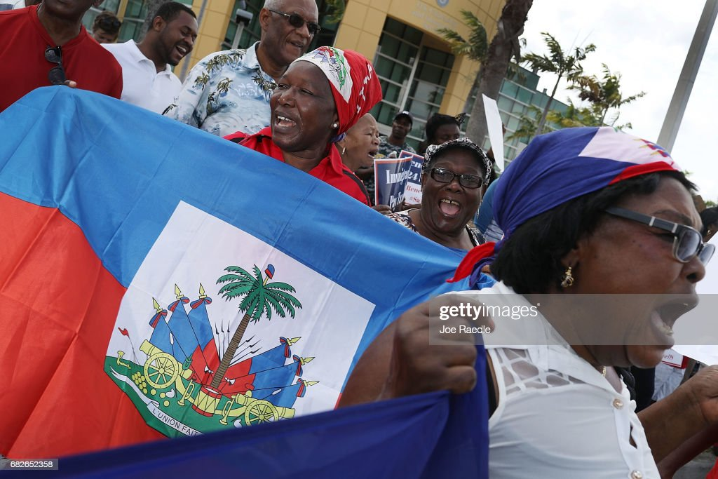 People protest the possibility that the Trump administration may overturn the Temporary Protected Status for Haitians in front of the U.S. Citizenship and Immigration Services office on May 13, 2017 in Miami, Florida. 50,000 Haitians have been eligible for TPS and now the Trump administration has until May 23 to make a decision on extending TPS for Haitians or allowing it to expire on July 22 which would mean possibly deportation for the current TPS holders.