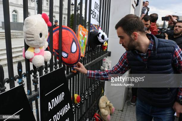 People protest the release of Boban Ilic pending trial on charges of causing the death of four year old Albanian boy Almir Aliu in Skopje, Macedonia...