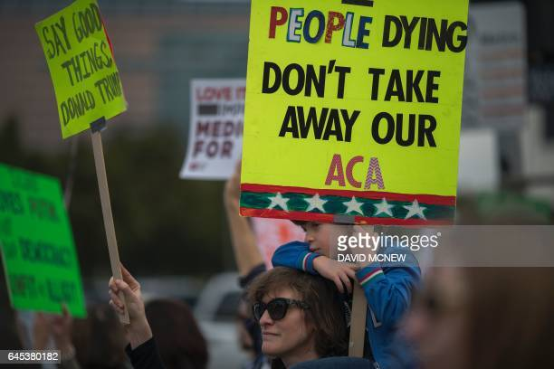 People protest Trump administration policies that threaten the Affordable Care Act Medicare and Medicaid near the Wilshire Federal Building on...