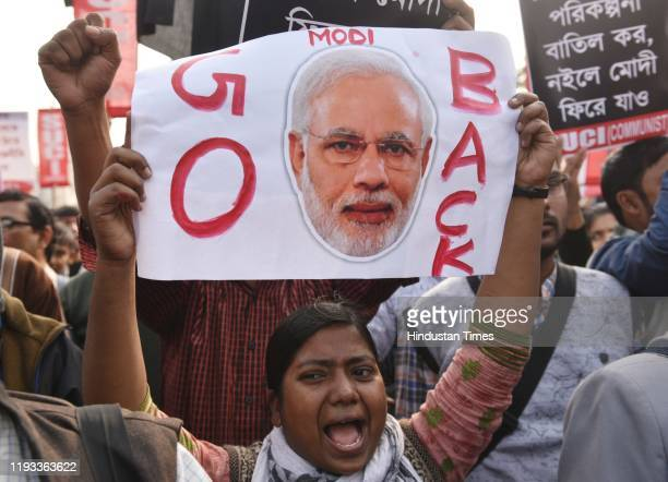 People protest with black flags against Prime Minister Narendra Modi on the day of his arrival on a two day visit to the city, on January 11, 2020 in...