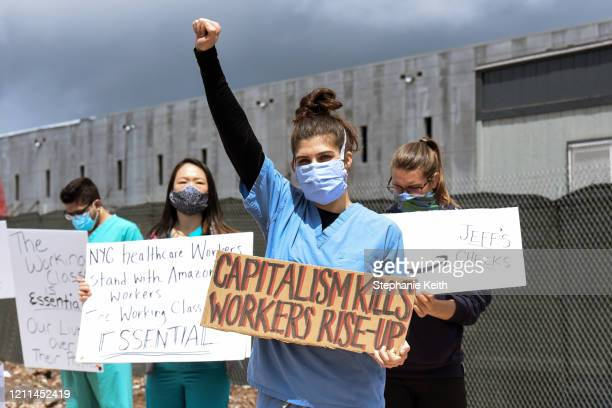 People protest working conditions outside of an Amazon warehouse fulfillment center on May 1 2020 in the Staten Island borough of New York City...