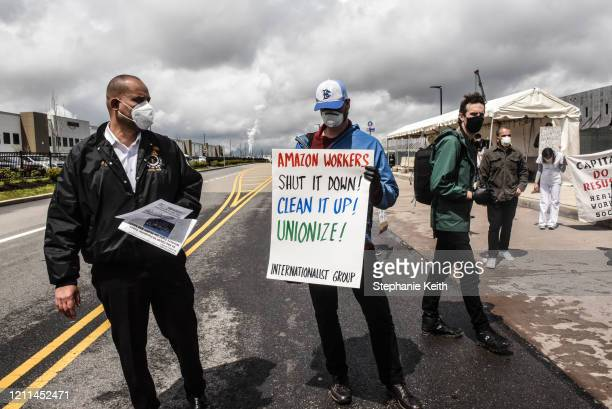 People protest working conditions outside of an Amazon warehouse fulfillment center on May 1, 2020 in the Staten Island borough of New York City....