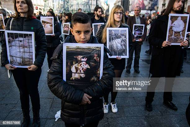People protesting against animal cruelty in industry during the International Animal Rights Day