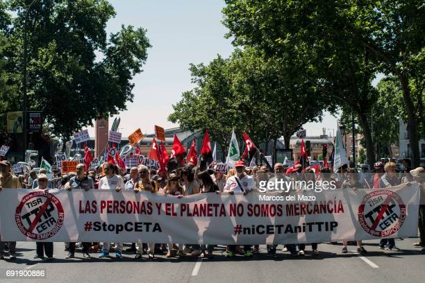 People protesting against CETA trade deal during a demonstration demanding Spanish government not to ratify trade agreement between Canada and EU