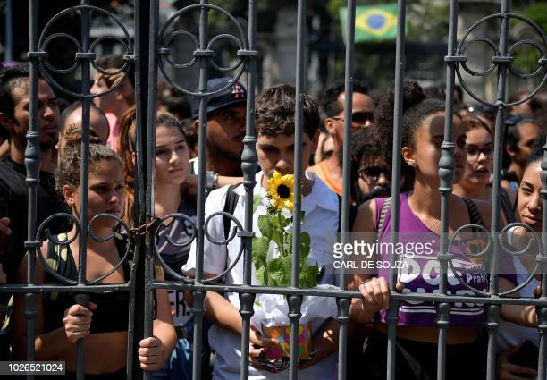 TOPSHOT People protesting against the Brazilian Federal Government at the gates of the Quinta da Boa Vista park on September 3 2018 a day after a...