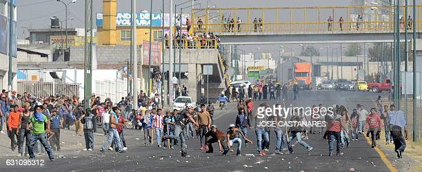 People protesting against the rise of fuel prices clash with the police in Puebla Mexico on January 6 2017 The death toll in protests against a...
