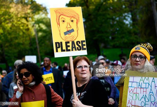 TOPSHOT People protesting against US President Donald Trump wait near the Tree of Life Congregation on October 30 2018 in Pittsburgh Pennsylvania The...