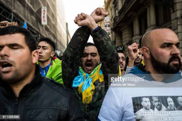 People protesting calling for the release of political prisoners in the Rif region of Morocco during a demonstration where hundreds of people from...
