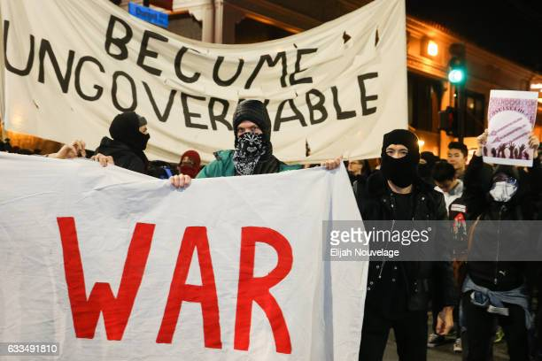 People protesting controversial Breitbart writer Milo Yiannopoulos take to the streets on February 1 2017 in Berkeley California A scheduled speech...