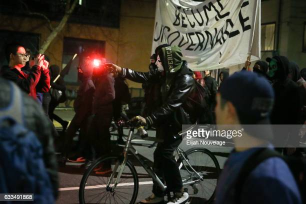 People protesting controversial Breitbart writer Milo Yiannopoulos march in the street on February 1 2017 in Berkeley California A scheduled speech...