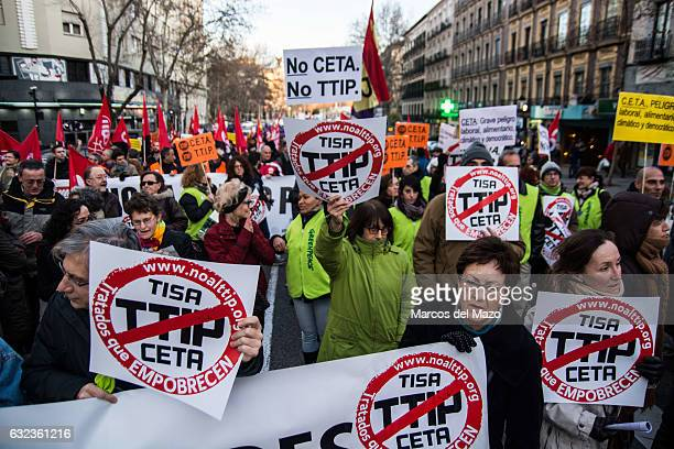 People protesting during a demonstration against CETA TTIP and TISA agreements