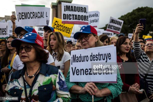 People protesting during a demonstration against Venezuelan president Nicolas Maduro and supporting Juan Guaido. Protesters are demanding the end of...