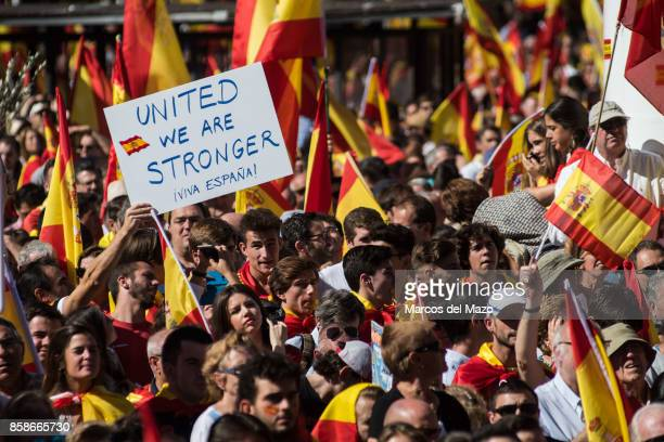 People protesting during a demonstration demanding the unity of Spain and against the independence of Catalonia