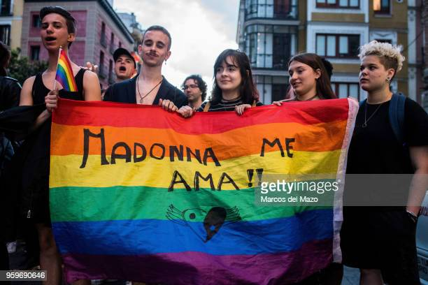 People protesting during the International Day Against Homophobia, Transphobia and Biphobia to demand equality for LGBT community. In the flag the...