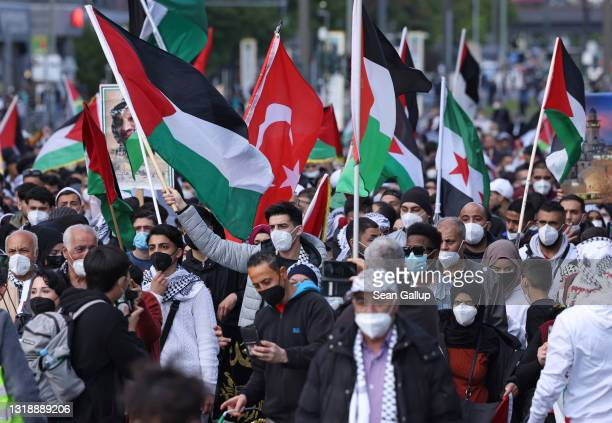 People protesting for the rights of Palestinians and against the Israeli military bombardments of Gaza march on May 19, 2021 in Berlin, Germany....