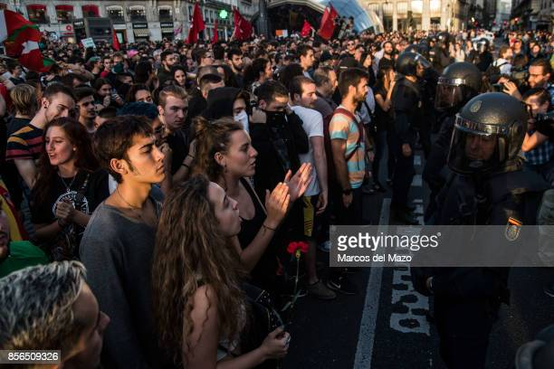 People protesting shouting against riot police supporting referendum in Catalonia