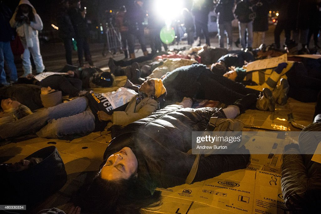 People protesting the Staten Island, New York grand jury's decision not to indict a police officer involved in the chokehold death of Eric Garner in July, hold a die-in outside the beauty salon where Garner died, December 11, 2014 in the Staten Island Neighborhood of New York City. Protests have continued throughout the country since the Grand Jury's decision was announced last week.