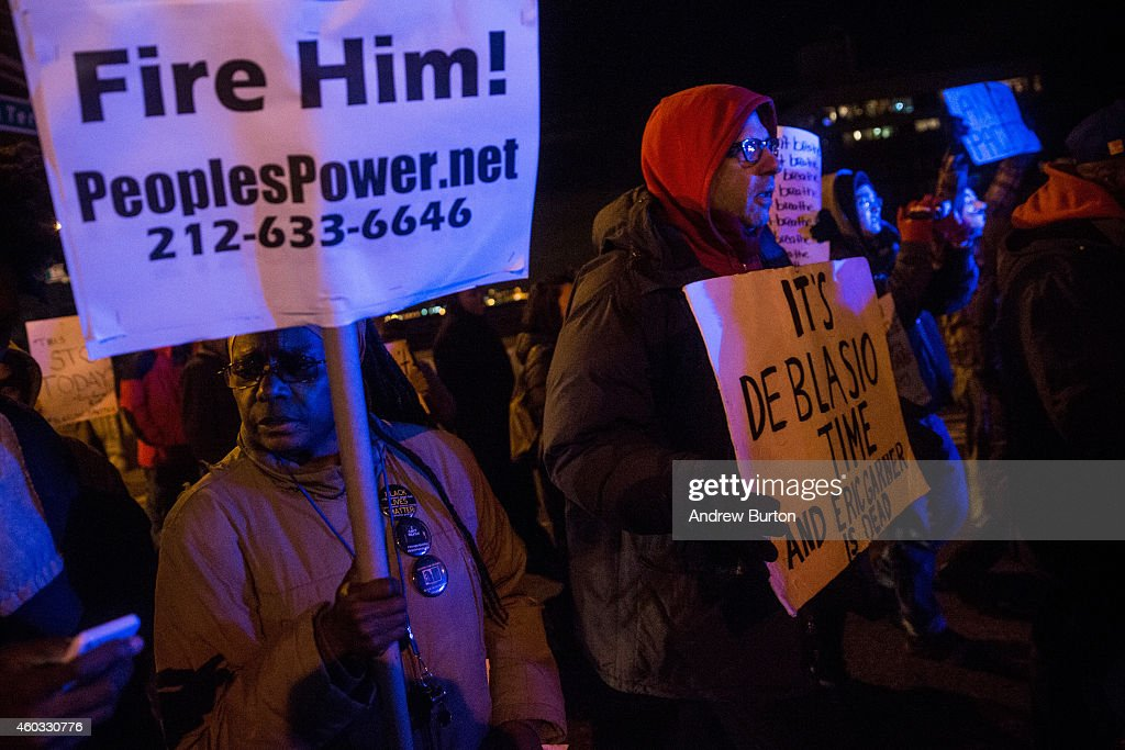 People protesting the Staten Island, New York grand jury's decision not to indict a police officer involved in the chokehold death of Eric Garner in July, march to the spot where Garner died on the night , on December 11, 2014 in the Staten Island Neighborhood of New York City. Protests have continued throughout the country since the Grand Jury's decision was announced last week.