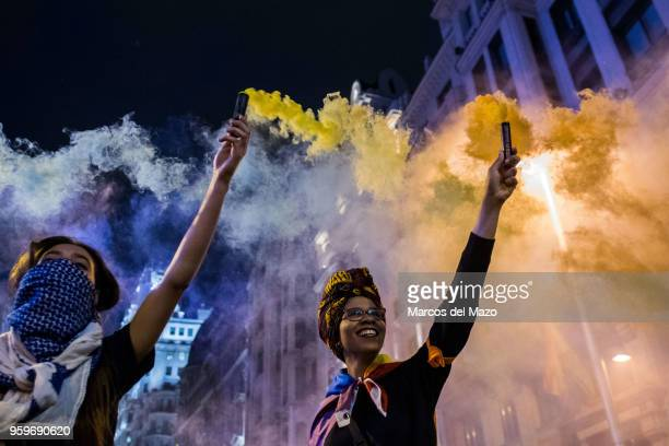 People protesting with colored smoke during the International Day Against Homophobia, Transphobia and Biphobia to demand equality for LGBT community.