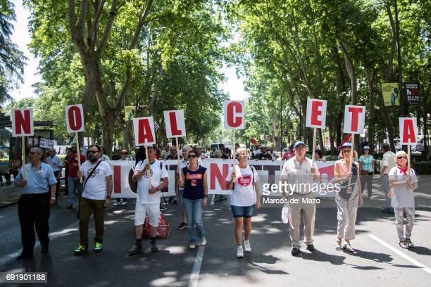 People protesting with placards against CETA trade deal during a demonstration demanding Spanish government not to ratify trade agreement between...