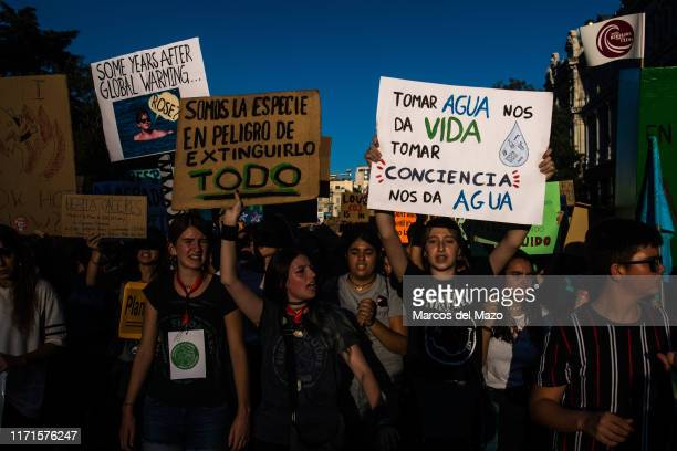 People protesting with placards demanding environmental policies during a global climate strike demonstration taking place at the end of a global...