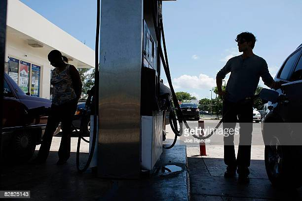 People pump gas into their vehicles September 15 2008 in Miami Florida Gasoline prices rose nearly 5 cents a gallon Monday bringing the total...