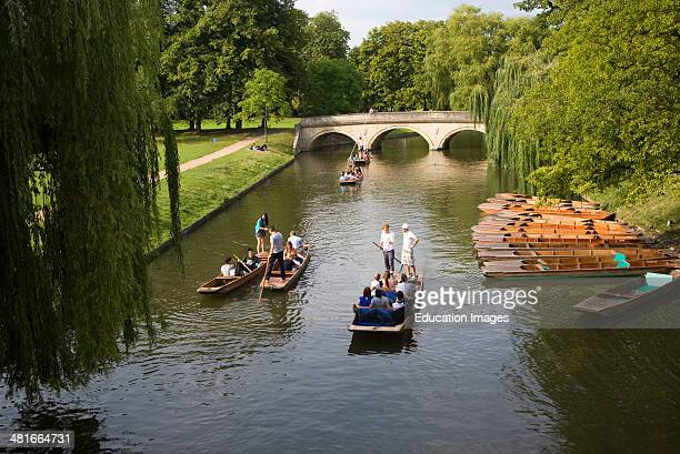 People punting in small boats on the River Cam Cambridge England