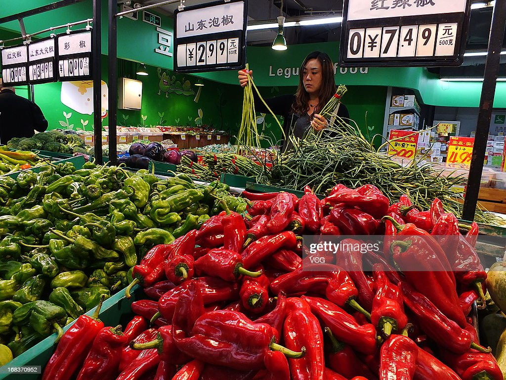 People purchase goods at a supermarket on May 9, 2013 in Yichang, China. China's consumer price index (CPI), the main gauge of inflation, rose 2.4 percent year-on-year in April.