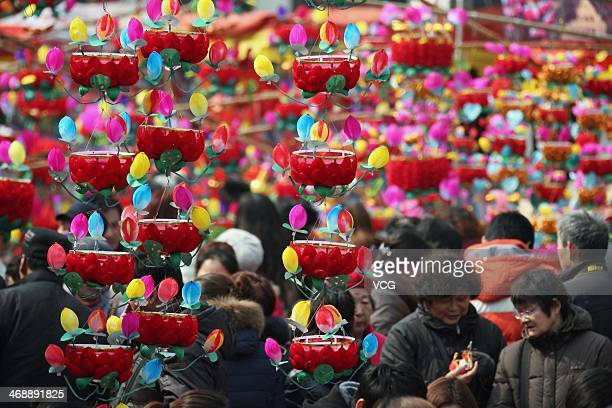People purchase lanterns at a market at Confucius Temple on February 11 2014 in Nanjing China Lantern Festival is a Chinese festival celebrated on...