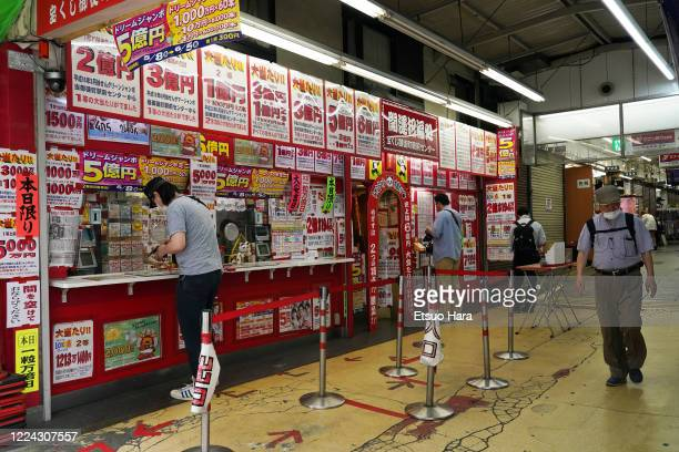 People purchase lottery amid the coronavirus pandemic on May 12, 2020 in Tokyo, Japan.