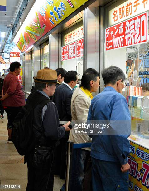 People purchase lottery tickets of the 'Dream Jumbo Lottery' at Nagoya Station on May 13 2015 in Nagoya Aichi Japan The lottery which first prize is...