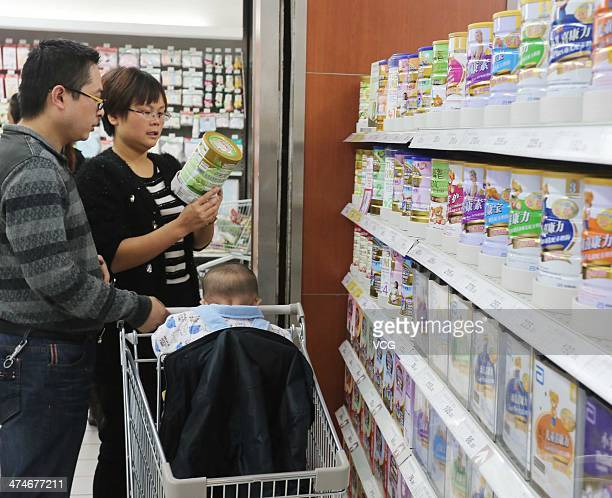 People purchase milk powder at a surpermarket on October 19 2013 in Xuchang Henan Province of China