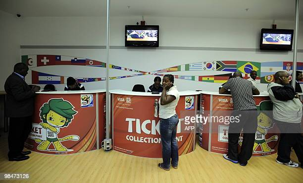 People purchase official 2010 FIFA World Cup tickets on April 15 2010 at the Maponya shopping mall in Soweto during the first day of the opening...