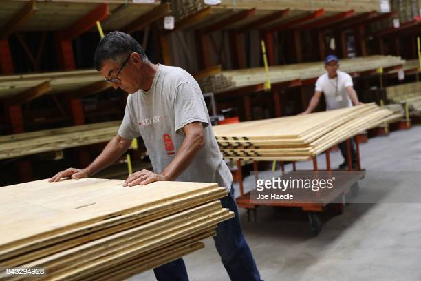 People purchase plywood at The Home Depot as they prepare for Hurricane Irma on September 6 2017 in Miami Florida It's still too early to know where...