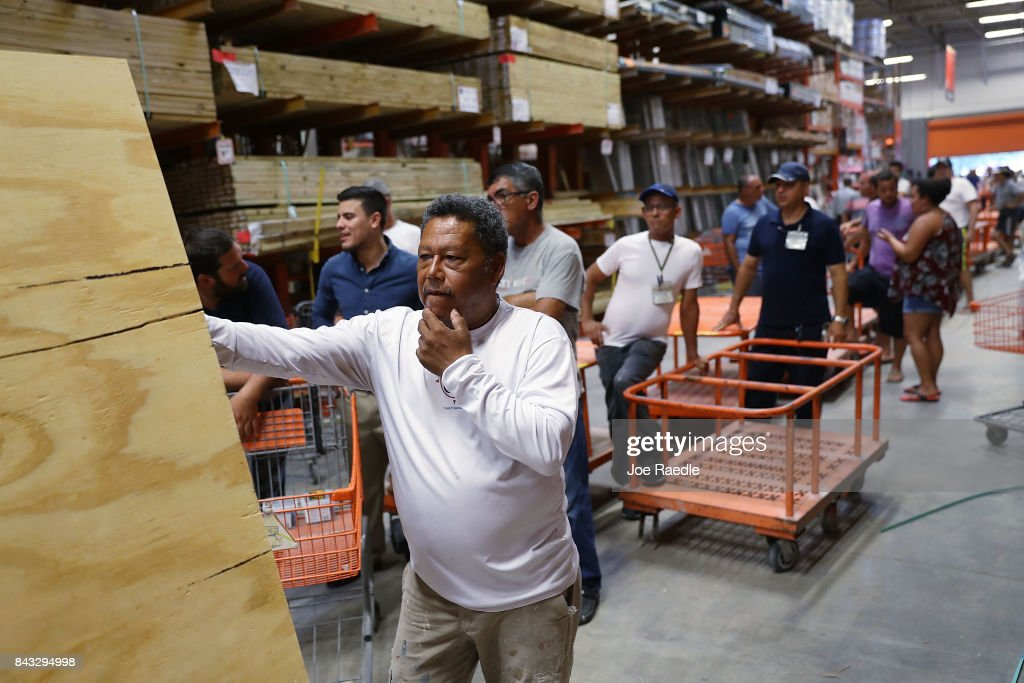 People purchase plywood at The Home Depot as they prepare for Hurricane Irma on September 6, 2017 in Miami, Florida. It's still too early to know where the direct impact of the hurricane will take place but the state of Florida is in the area of possible landfall.